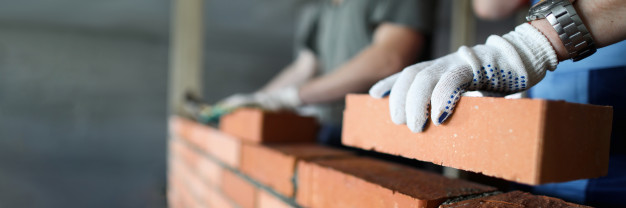 two workers making red brick wall construction site close up 151013 6790