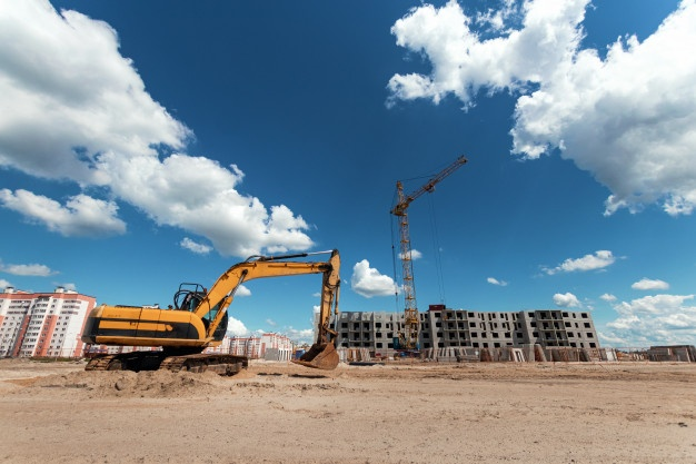 excavator construction site against background tower crane 99433 155